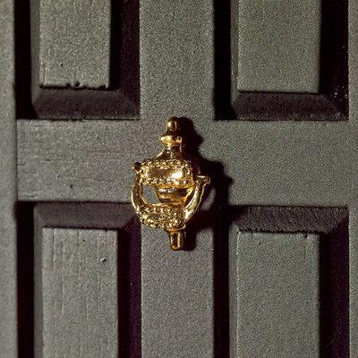 Geel koperen deurklopper