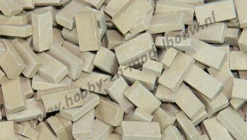 Donkerbeige steen 1:43/50. Afm.: 5,3 x 2,6 x 1,3 mm