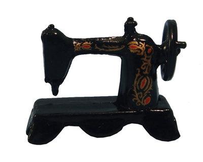 Zwarte naaimachine tafelmodel