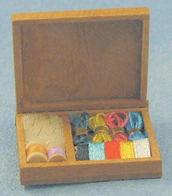 Diverse linten in houten doos